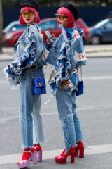 Street style twins Ami and Aya Suzuki arriving at the Dior show at Paris Fashion Week.