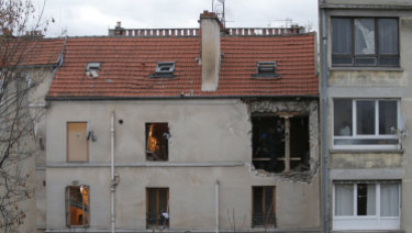 The building of the police raid on an apartment is pictured in Paris suburb Saint-Denis.