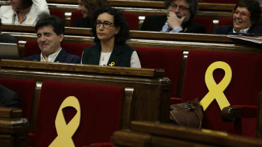 Yellow ribbons in support of Catalonian politicians who have been jailed on charges of sedition are displayed before a parliamentary session in Barcelona.