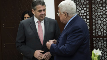 German Foreign Minister Sigmar Gabriel, left, meets with the Palestinian President Mahmoud Abbas, in the West Bank Town of Ramallah.