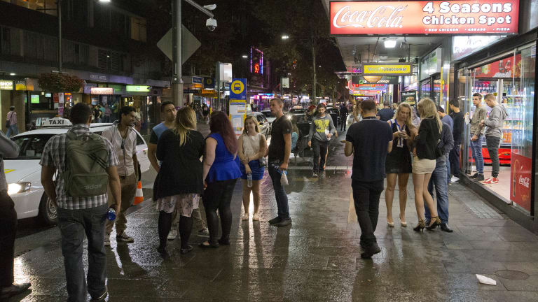 Homeward bound: partygoers fill the streets of Kings Cross on the first weekend of new lockout laws.