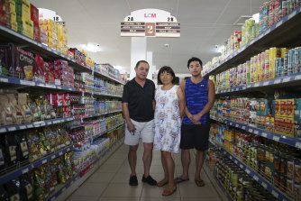 Business owners Richard and Rosemary Lo - pictured with son Mathew - have noticed a shift in sentiment.