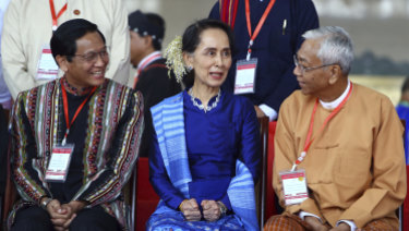 Myanmar's de facto leader Aung San Suu Kyi, with President Htin Kyaw, right, and Vice President Henry Van Hti Yu, left.