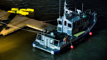 Yellow buoys that a New York police officer said are suspending a helicopter that crashed into the East River.