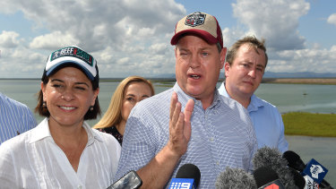 Mr Nicholls (right) and LNP deputy leader Deb Frecklington (left) hold a press conference at the Ross River Dam.