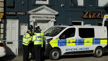 Police officers outside a restaurant in Salisbury, England, where traces of a nerve agent have been found.