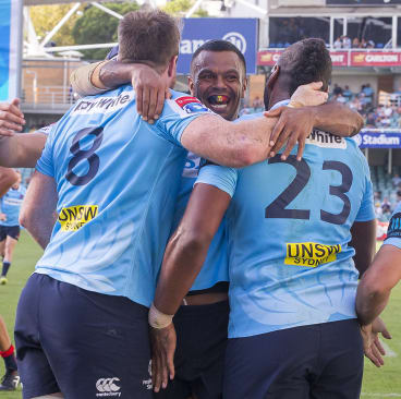 He's back: Waratahs congratulate Naiyaravoro on his try.