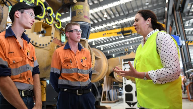 The Premier chats to young apprentices as she visits the Hastings Deering workshop in Mackay.