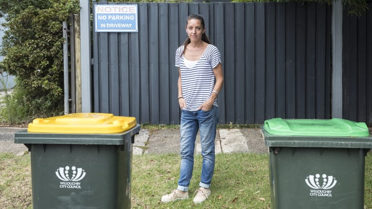 Heidi Williams has resorted to 'no parking' signs and wheelie bins to deter drivers from blocking the driveway of her Willoughby home.