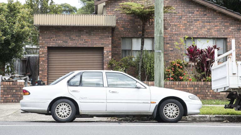 A car parked across a driveway in Willoughby.