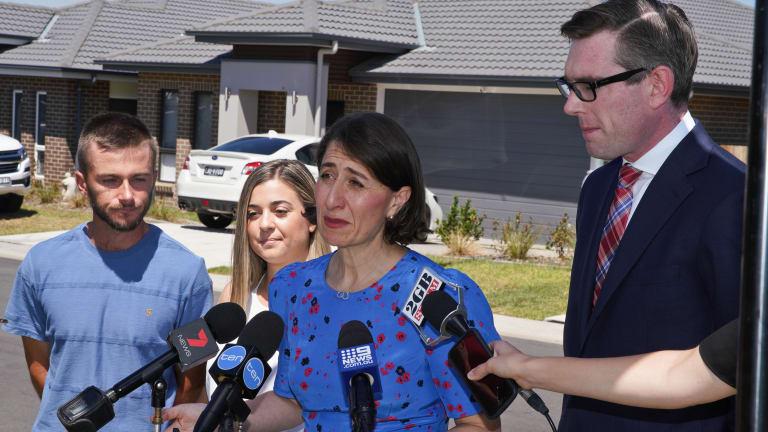 NSW Premier Gladys Berejiklian and NSW Treasurer Dominic Perrottet speaking in Oran Park, western Sydney,  on Sunday.