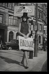 Model holding a Bazaar Carrier Bag 1959.