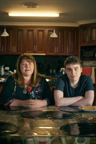 """Callum with his mother Melinda Milkins: """"we cannot force him to go to a place that is causing trauma and harm."""""""