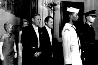 President Nixon and Australian Prime Minister John Gorton and their wives follow members of the honor guard to tonight dinner in the White House Honoring Gorton's visit. May 6, 1969.