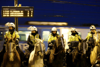 Police assemble at Broadmeadows train station to manage people protesting against Lauren Southern who is in Australia on a speaking tour.