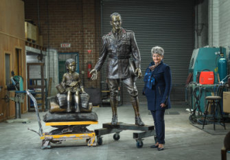 Towering figure: Litsa Athanasiadis with the monument depicting George Treloar and a Greek Pontian refugee girl.