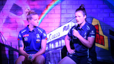 Brianna Davey (right) and Hannah Scott will face off in the AFLW Pride Game.