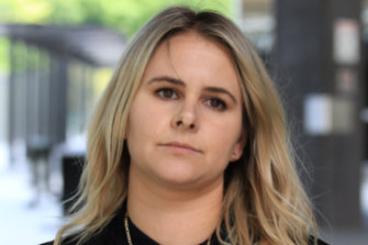 Graeme Langlands' defence solicitor, Jessica Burke, leaves the Brisbane Magistrates Court earlier this month.