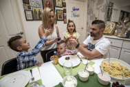 Cracking fun: Paul and Maria Manolis crack eggs with their kids James, Anastasia and Nikolai (centre).