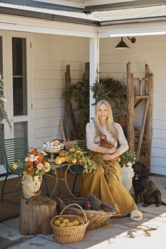Collette wears H Brand knit from The South Store, Chez Dédé skirt, Country Road slides and Fairley jewellery.