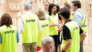 Queensland Premier Annastacia Palaszczuk (centre) walks away after a press conference at the TAFE Skill Centre at Acacia Ridge