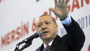 Turkey's President Recep Tayyip Erdogan, gestures during a rally of his ruling Justice and Development (AKP) Party's supporters on Saturday.