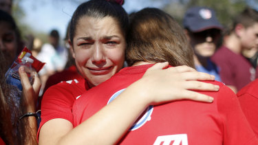 A student mourns the loss of her friend during a community vigil in Parkland, Florida.