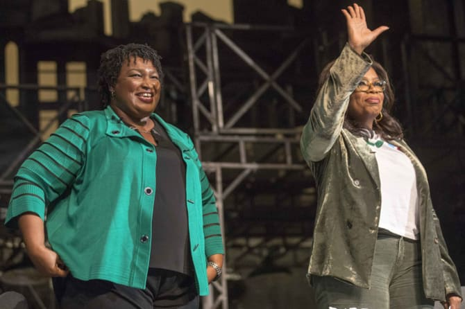 Stacey Abrams with talkshow host Oprah Winfrey, at a town hall talk in Atlanta just days before the midterms.