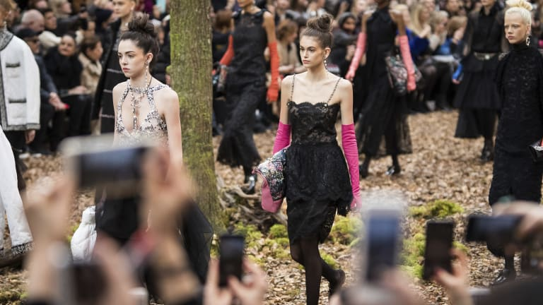 Chanel staged its show in a faux forest inside a marquee.