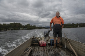 Oyster farmer Rick Christensen on his way up the Clyde River.