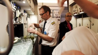 Airbus flight crew work in the galley of the  Airbus A350-1000 during its visit to Sydney.