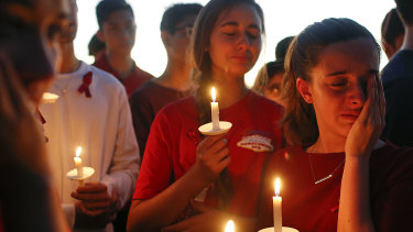 Students grieve at a vigil held for the victims of the school shooting at Parkland, Florida.