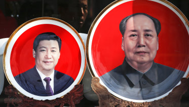 Souvenir plates bearing images of Chinese President Xi Jinping, and late Chinese leader Mao Zedong.