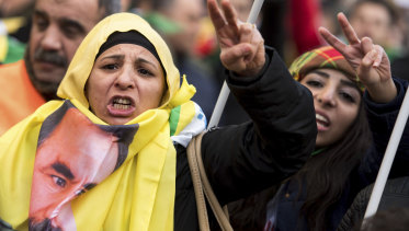Kurdish immigrants and supporters at a rally in Cologne, Germany, to protest against a Turkish military operation in a Kurdish enclave in northern Syria.