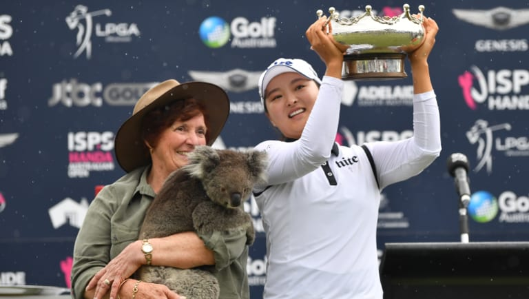 Bearing up well: Jin Young Ko celebrates with her trophy, and 'Honey' the koala (held by Rae Campbell), after winning the Australian Women's Open in Adelaide.