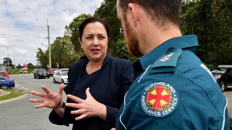Premier Annastacia Palaszczuk speaking to a paramedic in the new Logan electorate of Macalister on Wednesday.