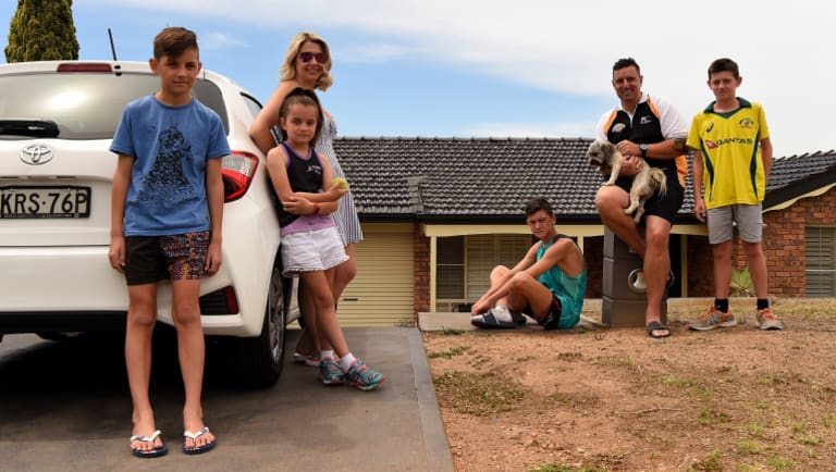 The Haywood family in front of their home in Erskine Park: Ryan Haywood 11, Keeley Haywood 8, Kristy Haywood, Lachlan Haywood 15, Cameron Haywood holding Tigah, and Joel Haywood 13.