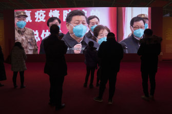 Residents attend an exhibition on the city's fight against the coronavirus in Wuhan on January 23, a year after it was locked down to contain the spread of coronavirus.