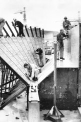 Carpenters work on the wooden moulding for part of the Opera House roof in 1963.