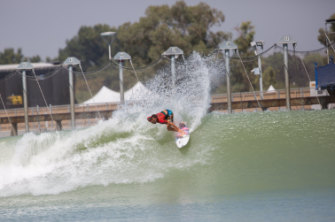 A surfer rides a wave at California's Surf Ranch.