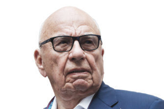 In a fog: Rupert Murdoch makes quite an entrance to Australia.