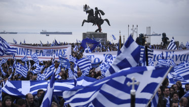 "Greek protesters wave flags and banners during a rally against the use of the term ""Macedonia"" for the northern neighbouring country's name, at the northern Greek city of Thessaloniki on Sunday."