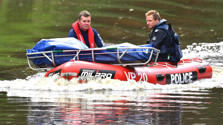 Police retrieve a body from the Yarra on Tuesday afternoon.