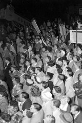 Angry crowds at the airport on April 19, 1954.