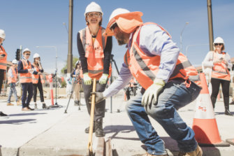 Minister for Transport Meegan Fitzharris helping install the last section of rail along the Gungahlin to the city light rail corridor last month.
