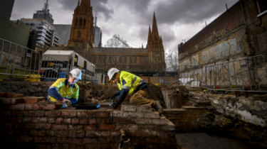 Can you dig it: Workers Wren Lakeman and Joe Page at the archaeological dig opposite St Paul's Cathedral in Swanston Street.