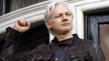 WikiLeaks founder Julian Assange greets supporters outside the Ecuadorian embassy in London in May.