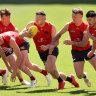 Steven May and his Demons teammates train the day before the grand final.