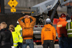 Police investigate the scene of a construction crane collapse in Seattle that left four dead.