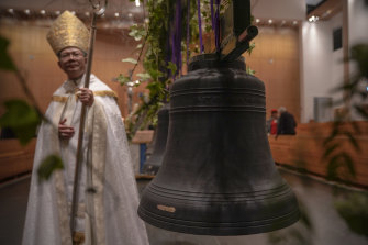 The Bishop of Parramatta Vincent Long with the bells after they were anointed and blessed with oil and incense.